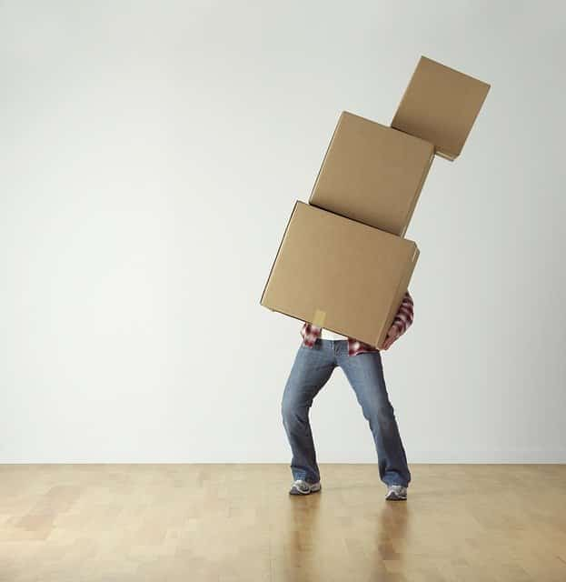 Man holding three moving boxes